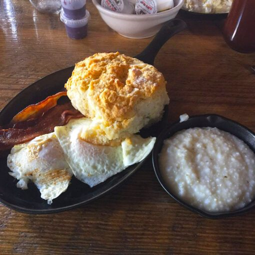 "The ""Traditional"" with Two Eggs, Bacon, Grits and a Biscuit."